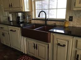 double bowl copper a front sink in a kitchen