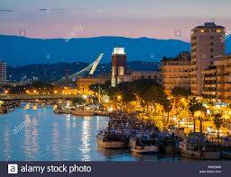 Pescara, Italy - The view in the dusk from Ponte del Mare monumental bridge  in the canal and port of Pescara city, Abruzzo region Stock Photo - Alamy
