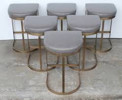 these flat bar milo baughman bar stools have been replated in a beautiful burnished brass which