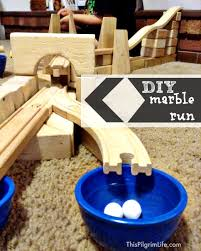 make a marble run with wooden train tracks and blocks