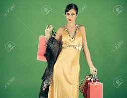 stock photo woman with retro hair makeup and ping bag pin up cute fashion model on green background in yellow dress boa with bag or gift