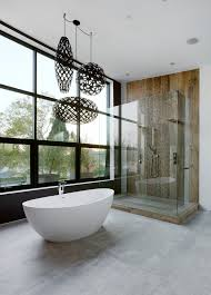 full height glass widow c pendant lights dark lights freestanding tub shower wall concrete floor