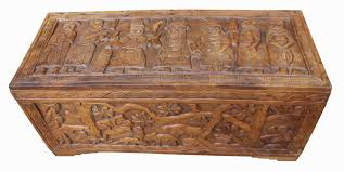 a good quality benin carved wood trunk