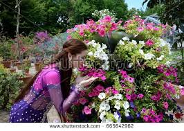 beautiful bollywood woman in botanic garden with flowers