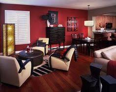 living room ideas with red accent wall. warm color scheme with the red walls and brown orange accents. find this pin more on living room design ideas accent wall i