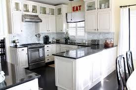 kitchen ideas white cabinets black appliances. Combine Grey Backsplash And Dark Granite Countertop In Cozy Kitchens With White Cabinets On Oak Flooring Kitchen Ideas Black Appliances W