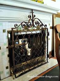 old wrought iron gate repurposed as decorative fireplace screen