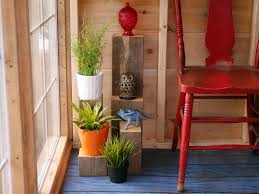 diy s wood plant stands in a salvaged material greenhouse cabin flea market finds you