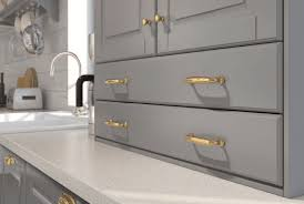 N A Kitchen With Light Grey Doors And Brass Handles
