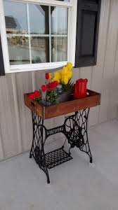 Table I made from Singer sewing machine base and an old crate ...