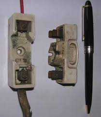 photos holder or 2 as a cartridge fuse where the fuse is enclosed in a sealed heat resistant container the downside of using fuses is that they always have