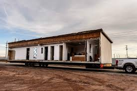 Trent Nelson | The Salt Lake Tribune A group of FLDS members move a modular  home