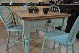 this rustic shabby chic dining table with drawer es with four stickback chairs and is painted in an annie sloan provence old white mix