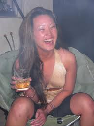 Asian amateur Miko Sinz drinking alcohol before doing her first.