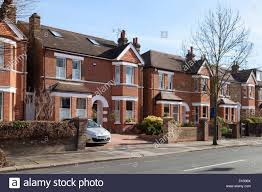 Detached Houses On A Street In Ealing West London Uk Stock Photo