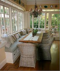 Pretty dining room! Love the windows! LIke the banquet seat along one side  to