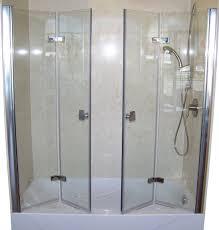 folding bathtub shower doors home ideas emilydangerband folding with regard to folding bathroom doors