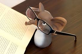 cartoon image of a mouse wearing glasses reading a book