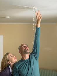 remove water stain from ceiling. Unique Water Mid Adult Woman Next To Mature Man Reaching Up Touch Water Falling From  Crack In On Remove Water Stain From Ceiling S