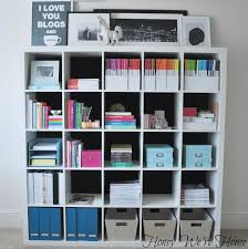 Utilize the inexpensive IKEA Expedits and add your own fabric for custom  bookshelves. Via Honey