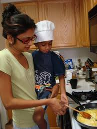 a peek into the thevar household changing professions here s my little chef helper photo credit julie
