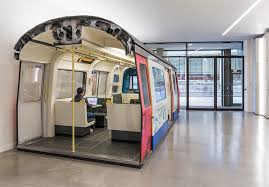 Tube office Quadrifoglio At The Same Time The Nonrolling Stock Has Been Refitted For Office Use Heres Someone Using The Wifi Londonist Why Is There Tube Train Inside An Aldgate Office Londonist