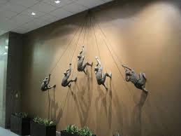 trendy climbing man wall art plus rope decor position black color
