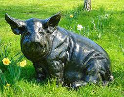 large sitting metal garden pig sculpture