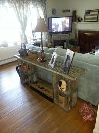 sofa table made from shutter and old wood milk crates cover top with glass