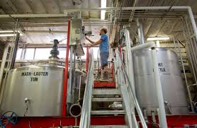 embrace monitor. a worker at ballast point brewing checks monitor. the craft brewer sold itself to embrace monitor