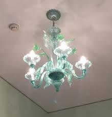 hotel bonvati murano glass chandelier in room