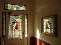 repair and restoration of daniel cottier stained glass door and side panels glasgow west end