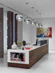 unique office decor. Silver Ball Shaped Pendant Lamps And Wooden Ikea Reception Desk For Unique Modern Office Decor E