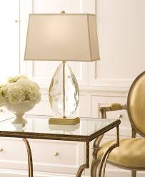 modern cut crystal table lamp on the wrought-iron table with glass top;  crystal