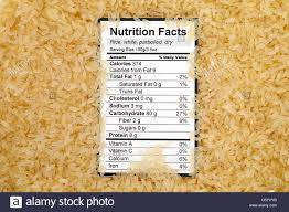 nutrition facts of dry white parboiled rice with rices background stock image