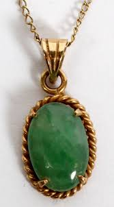 lot 1496 14kt yellow gold jade pendant necklace l 14 a 14kt