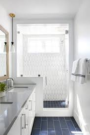 blue bathroom floor tiles. A Seamless Glass Shower Fitted With White Geometric Wall Tiles Fixed Framing Window Located Adjacent Blue Bathroom Floor O