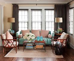 Restful shades of blue and pink pretty up a sitting room but a good dose of  brown will ground these pastel hues and lend a sophisticated touch.