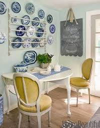 the simple plate rack and yellow upholstered chairs dining areakitchen