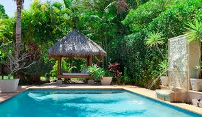 small pool cabana. Backyard With Swimming Pool And Thatched Cabana Daybed Small