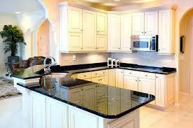 white cabinets black countertops cool white kitchen