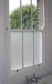 This double glazed sash window in a Bathroom has the added benefit of  sandblasted privacy glass