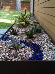 steel planter with succulents river rock and blue glass large landscaping rockslandscaping