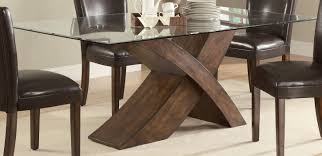 glass oval dining table with oak legs