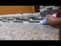caulking kitchen backsplash. How To Caulk On A Kitchen Backsplash - Seal The Gap Between Granite And Mosaic. Caulking
