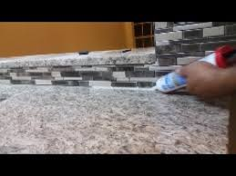 how to caulk on a kitchen backsplash seal the gap between granite and mosaic