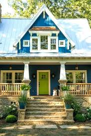 blue farmhouse blue cottage with green door hooked on houses siding paint color porcelain door color blue farmhouse