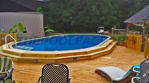 semi inground pool cost. A Nice Wooden Deck Built Around Semi Inground Pool Cost Of Above Ground