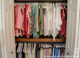 organiizing closet with wood hangers