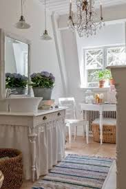 this is a gorgeous bathroom with a chandelier lit with candles and 2 hanging pendants chic crystal hanging chandelier furniture hanging